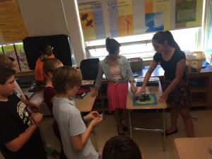 Students use a model to explain the setting of Jacob Have I Loved by Katherine Patterson.