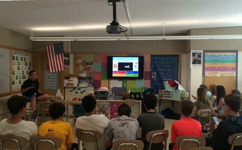 One student team has the class play an interactive Kahoot! quiz.